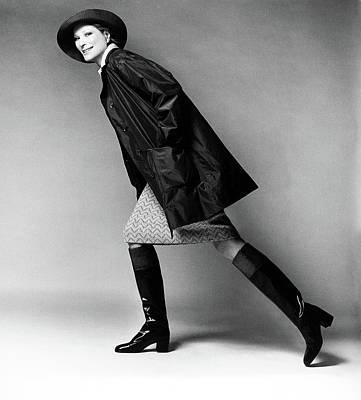 Raincoat Photograph - Nan Kempner Wearing A Raincoat And Hat by Francesco Scavullo