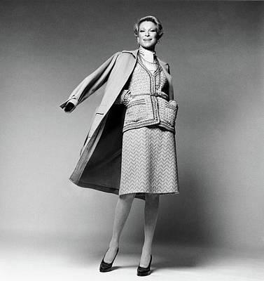 Nan Kempner Wearing A Wearing A Cardigan Art Print by Francesco Scavullo