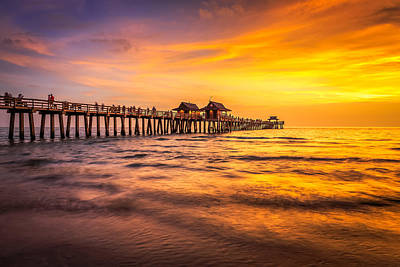 Photograph - Naples Pier Sunset by Hans- Juergen Leschmann