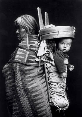 Woman And Baby Photograph - Navaho Woman Carrying A Papoose On Her Back by William J Carpenter