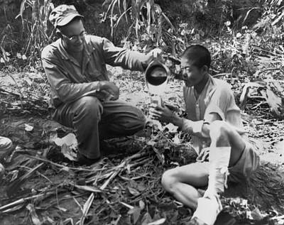 Healthcare And Medicine Photograph - Navy Medic Assists Pow by Underwood Archives