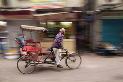 New Delhi, Pedicab, Rickshaw Speeds Art Print by Emily Wilson
