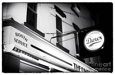Photograph - New York City At Night Diner Noir by John Rizzuto