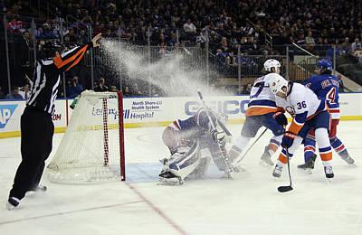 Photograph - New York Islanders V New York Rangers by Bruce Bennett