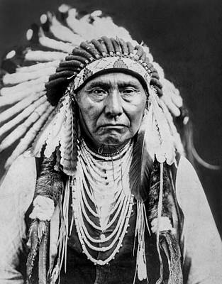 Portraits Royalty-Free and Rights-Managed Images - Nez Perce Indian man circa 1903 by Aged Pixel