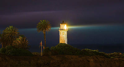 Photograph - Night Lighthouse On The Bluff by Jerry Cowart