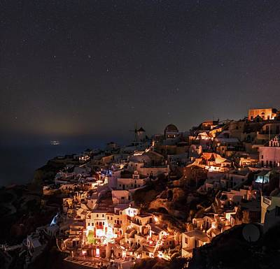 Night Sky Over Oia Art Print by Babak Tafreshi