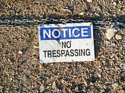 Photograph - No Trespassing Sign On Ground by Bryan Mullennix