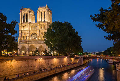 Photograph - Notre Dame Cathedral At Dusk With Blurred Boat Lights Over Seine by Gurgen Bakhshetsyan