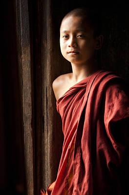 Novice Monk By The Door In Shwe Yaunghwe Kyaung Monastery Print by Ruben Vicente