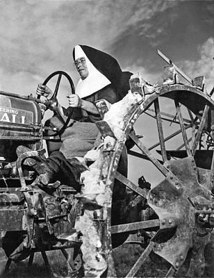 Photograph - Nun Runs Tractor On Farm by Underwood Archives