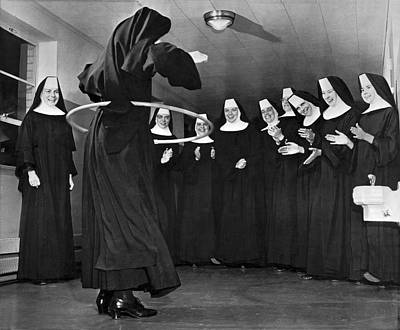 Amusing Photograph - Nun Swivels Hula Hoop On Hips by Underwood Archives