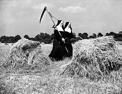 Nuns Harvest Oats In Fields Art Print