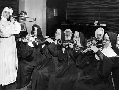 Coronet Photograph - Nuns Rehearse For Concert by Underwood Archives