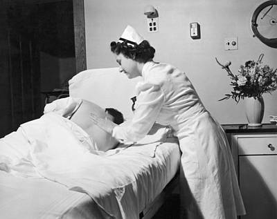 Nurse Gives Patient Rub Down Art Print by Underwood Archives