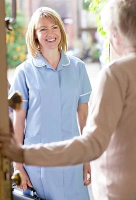 Healthcare And Medicine Photograph - Nurse On A Home Visit by Science Photo Library