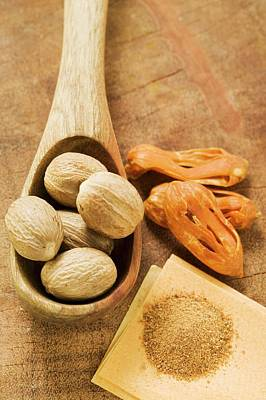 Grate Photograph - Nutmegs In Wooden Spoon, Mace And Ground Nutmeg by Foodcollection