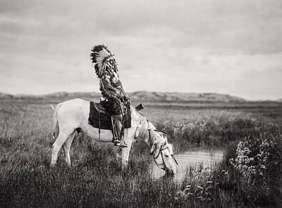 Animals Royalty-Free and Rights-Managed Images - Oglala Indian Man circa 1905 by Aged Pixel