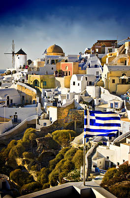 Print featuring the photograph Oia And A Greek Flag by Meirion Matthias