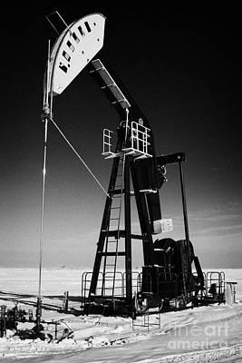oil pumpjack in winter snow Forget Saskatchewan Canada Art Print by Joe Fox