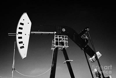 oil pumpjack in winter snow Forget Saskatchewan Art Print by Joe Fox