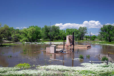 Oil Well Flooded By River Print by Jim West