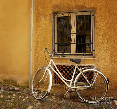 Photograph - Old Bicycle Against Wall by IPics Photography