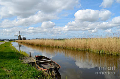 Photograph - Old Boat In A Canal In Holland by IPics Photography