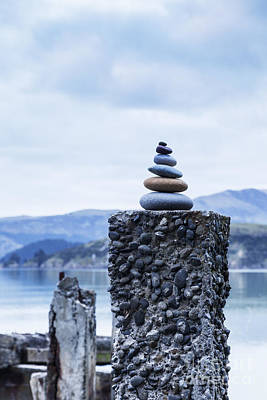 Stacked Stones Photograph - Old Concrete Jetty Posts Governors Bay Banks Peninsula New Zealand by Colin and Linda McKie
