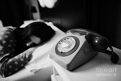 Old Fashioned Gpo Bt Phone On Bedside Table Of Early Twenties Woman In Bed In A Bedroom Art Print by Joe Fox