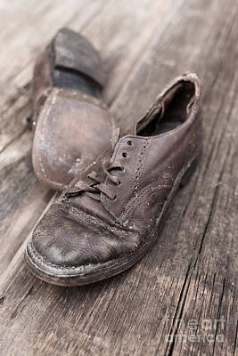 Wooden Floors Photograph - Old Leather Shoes On Wooden Floor by Edward Fielding