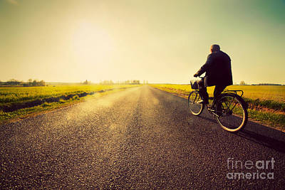 Asphalt Photograph - Old Man Riding A Bike To Sunny Sunset Sky by Michal Bednarek
