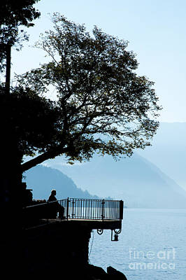 Overhang Photograph - Old Man Sitting In Shade Of Tree Overlooking Lake Como by Peter Noyce