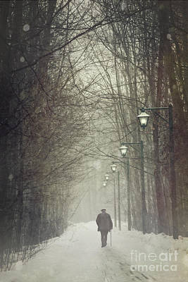 Photograph - Old Man Walking On Snowy Winter Path by Sandra Cunningham