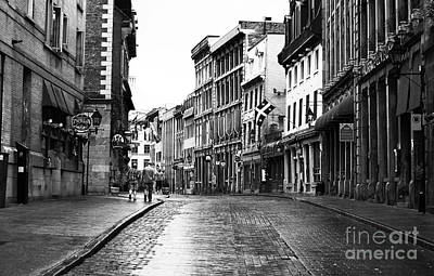 Of Artist Photograph - Old Montreal Streets by John Rizzuto