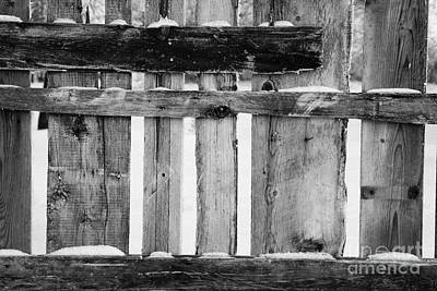 old patched up wooden fence using old bits of wood in snow Forget Art Print