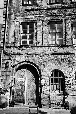 Kazimierz Photograph - Old Red Brick Crumbling Building In Kazimierz District With Plaster Facade Removed To Expose Brickwork Krakow by Joe Fox
