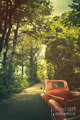 Photograph - Old Red Pickup Truck Driving On Dirt Road by Sandra Cunningham