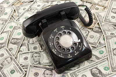 Photograph - Old Rotary Phone On Money Background by Keith Webber Jr