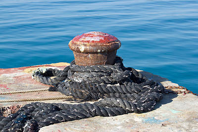 Photograph - Old Rusty Mooring Bollard On Pier by Brch Photography