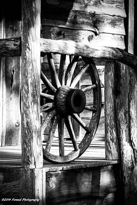 Photograph - Old Wagon Wheel  by Debra Forand
