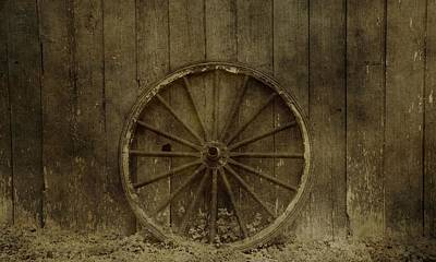 Old Wagon Wheel On Barn Wall Art Print
