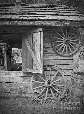 Photograph - Old Wagon Wheels On Out Building by Valerie Garner