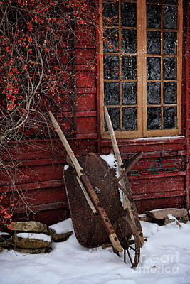 Old Wheelbarrow Leaning Against Barn In Winter Art Print