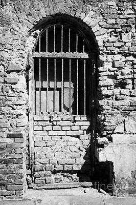 Old Jewish Area Photograph - Old Wooden Framed Window With Weathered Steel Bars Door Replacement In Red Brick Building With Plaster Removed Krakow by Joe Fox