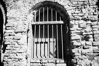 Old Wooden Framed Window With Weathered Steel Bars In Red Brick Building With Plaster Removed Krakow Art Print
