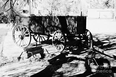 Wooden Farm Wagon Photograph - old wooden horse drawn farm wagon and sleigh bengough Saskatchewan Canada by Joe Fox
