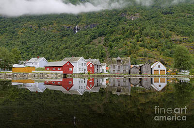 Norwegian Waterfall Photograph - Old Wooden Houses Reflected In Water At Laerdalsoyri Norway by Bart De Rijk