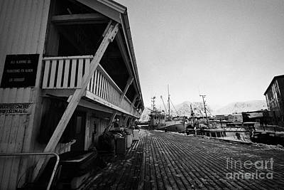 old wooden warehouses and buildings for drying fish Honningsvag harbour finnmark norway europe Print by Joe Fox