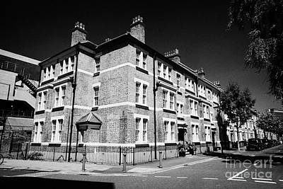 old yellow brick properties in the conservation area of mitre road waterloo London England UK Art Print